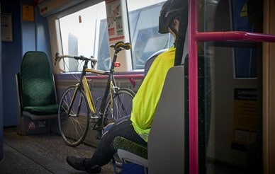 cyclist on train E