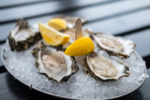 Oyster On Plate With Lemon.